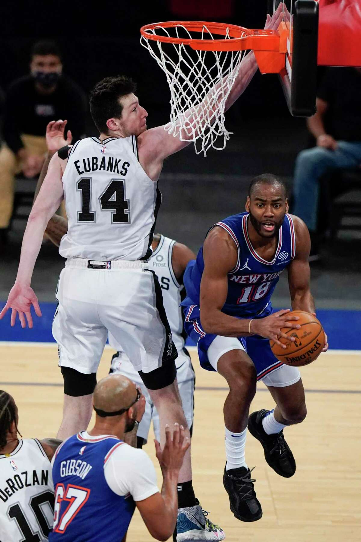 New York Knicks' Alec Burks (18) passes away from San Antonio Spurs' Drew Eubanks (14) during the second half of an NBA basketball game Thursday, May 13, 2021, in New York. (AP Photo/Frank Franklin II, Pool)