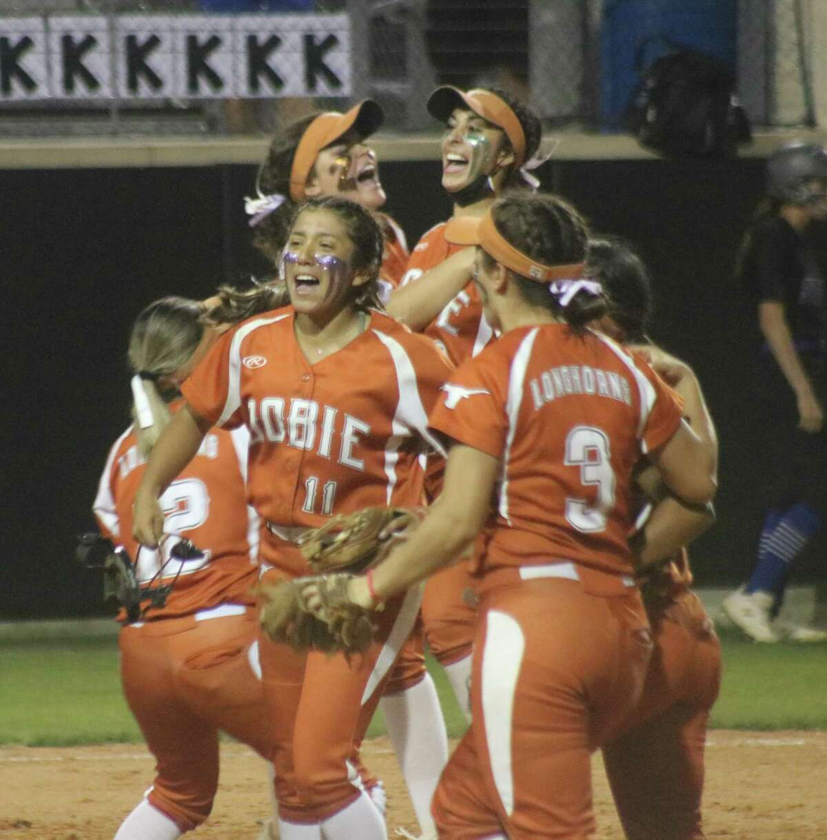 Dobie pitcher Marisa Perla (11) and her teammates rejoice over the triple play they just turned in Thursday night, escaping a sixth-inning jam in the process.