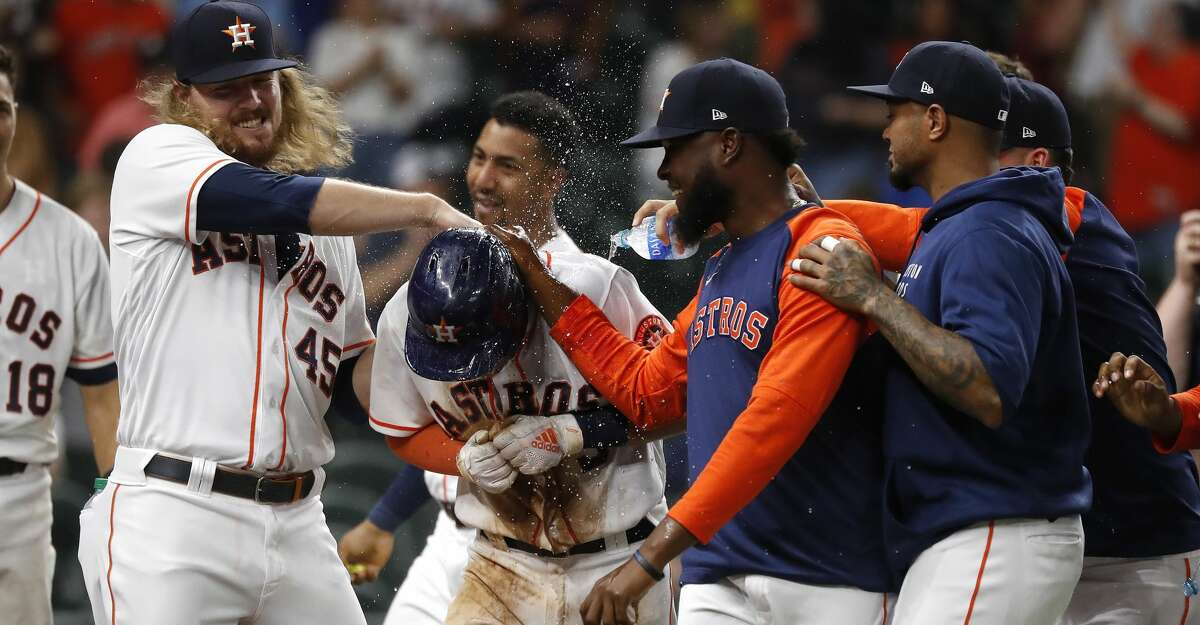 Houston Astros Myles Straw (3) celebrates with Ryan Stanek and starting pitcher Cristian Javier after he scored the winning run on a wild pitch by Texas Rangers pitcher Brett Martin during the eleventh inning of an MLB baseball game at Minute Maid Park, Thursday, May 13, 2021, in Houston. Astros win 4-3.