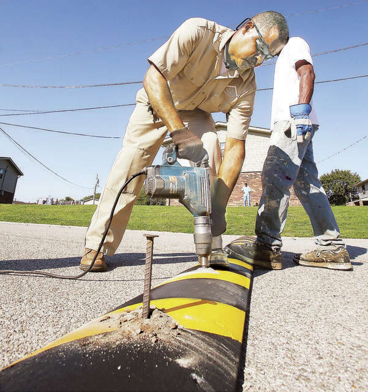 In this 2017 file photo, speed bumps are installed in Madison County. The installation is not likely on Esic Drive due to its status as a collector road, handling at least 1,000 vehicles a day per IDOT. Instead, those might be an option for some of the adjacent streets where residents say speeding is an issue.