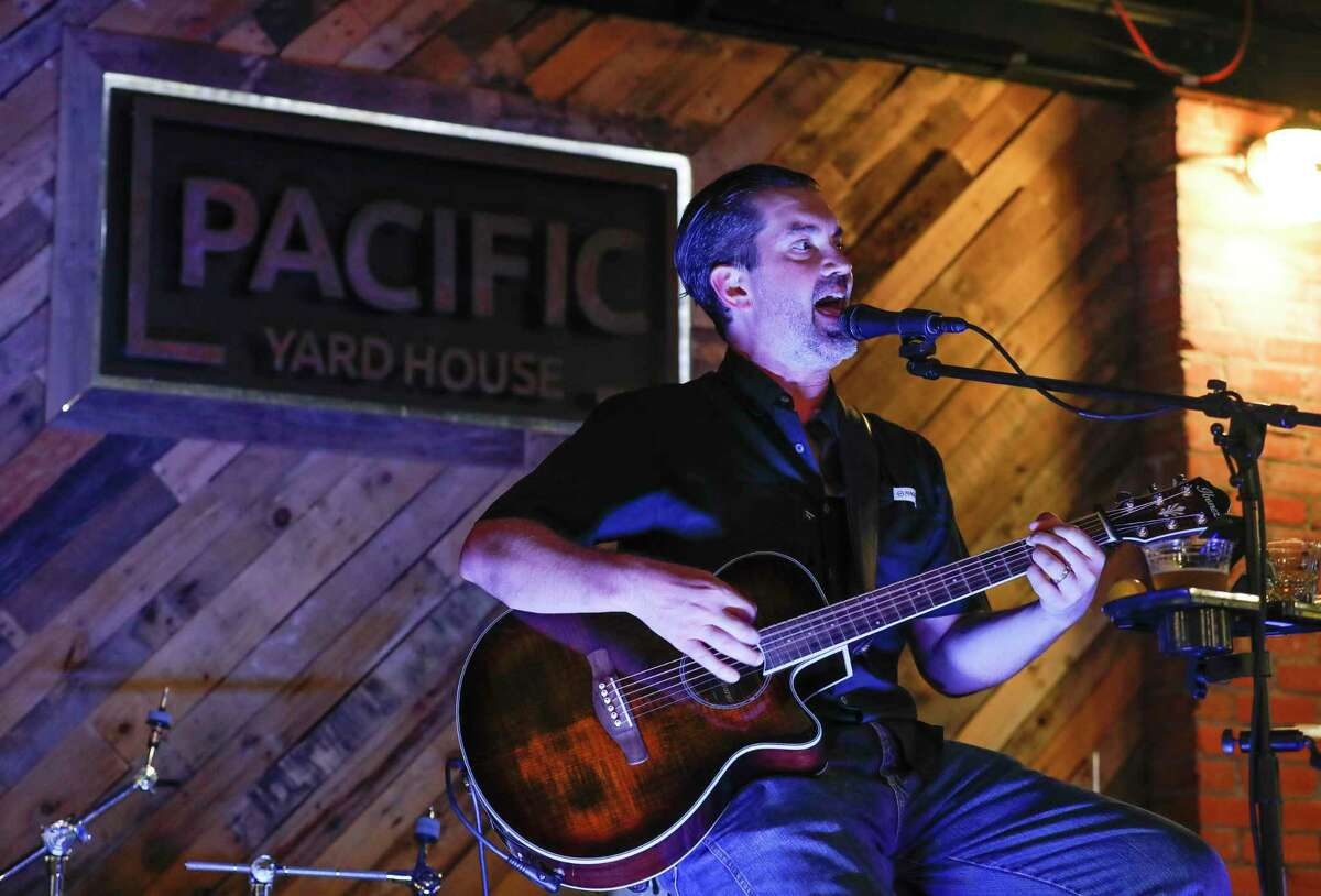 Chris Miller performs at Pacific Yard House, Wednesday, March 18, 2020, in Conroe. Pacific Yard House is among the growing number of establishments to offer live music in downtown Conroe.