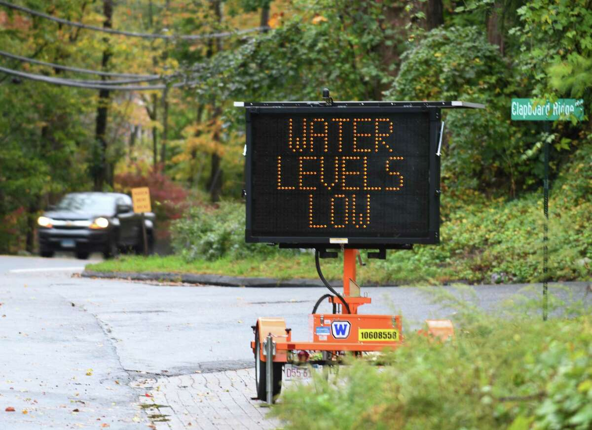 A sign notifies residents of low water levels at Putnam Reservoir in Greenwich last year.