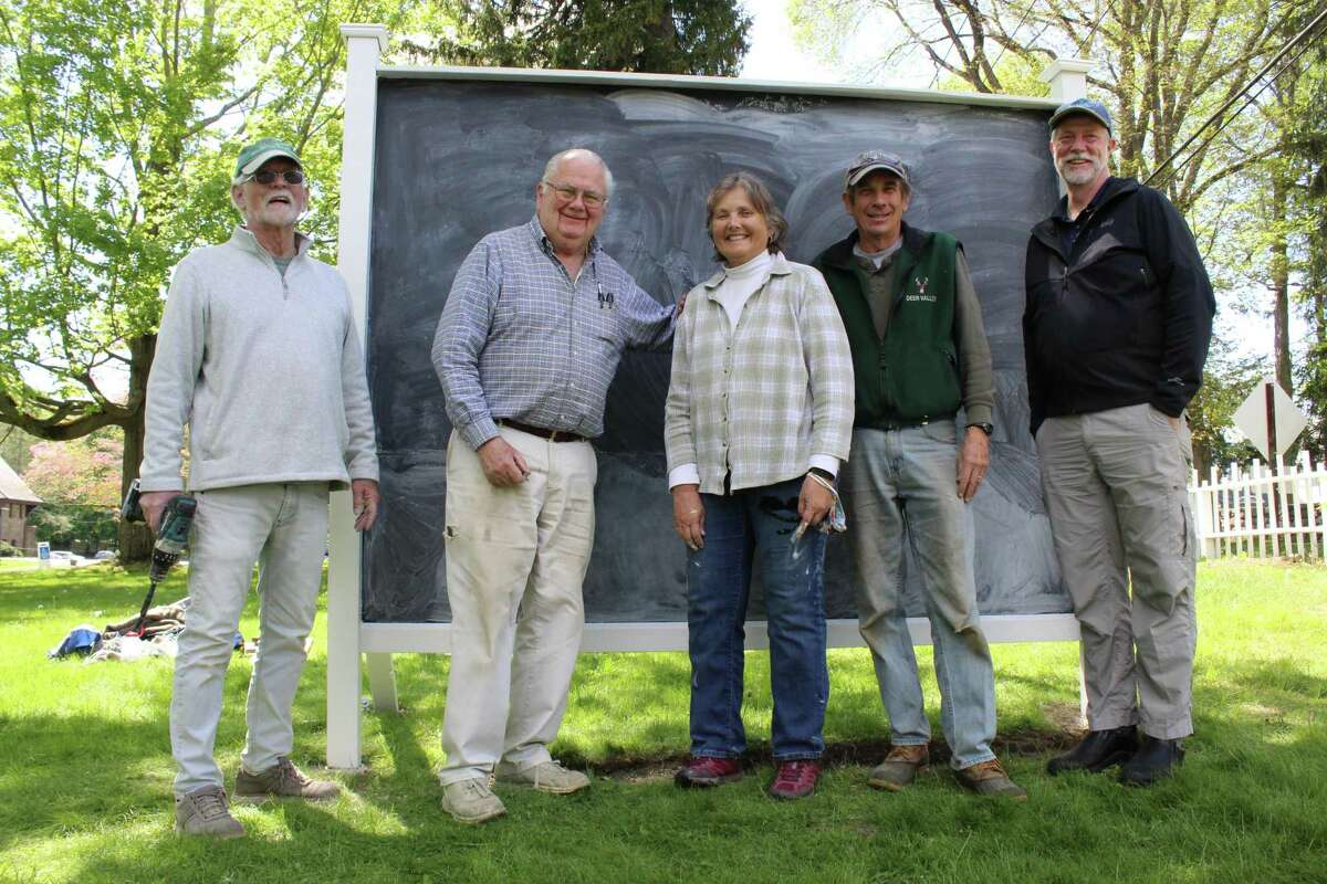 Jeff Vreeland, left, John Ward, Bonnie and Phil Kearns and Senior Pastor Bill Pfohl, of Jesse Lee Memorial United Methodist Church, pose outside the parish's Prayer Wall, an intitative aimed at bringing congregants and non-congregants together to share their hopes, desires and concerns as the world returns to normal.