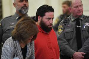 A file photo of Jose Morales (center) in court. Morales is expected to appear in Milford, Conn., court on Friday, May 14, 2021.