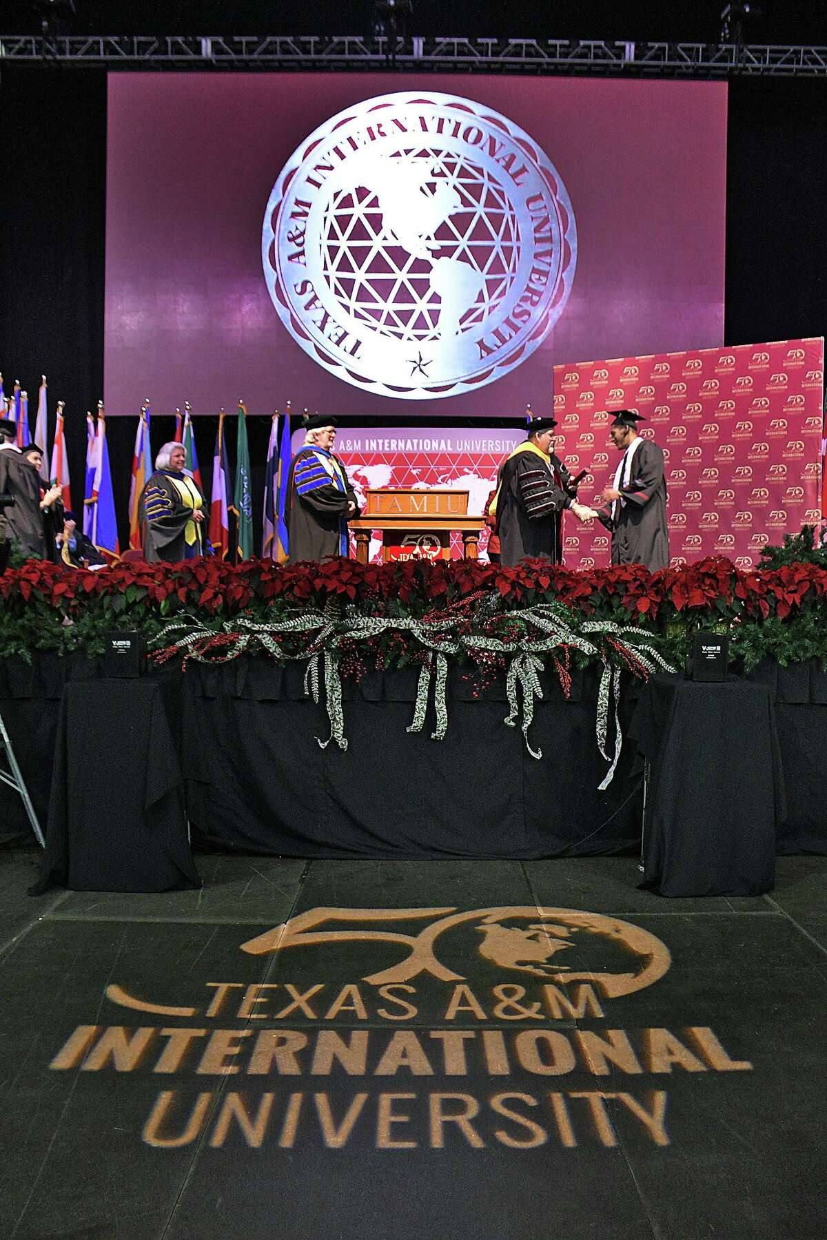 Over 800 candidates for graduation from Texas A&M International University participate in the Summer and Fall 2019 Commencement Exercises at Sames Auto Arena on Dec. 12, 2019. Commencement Speaker for the Fall Exercises was State Senator Judith Zaffirini (D-Laredo), left.