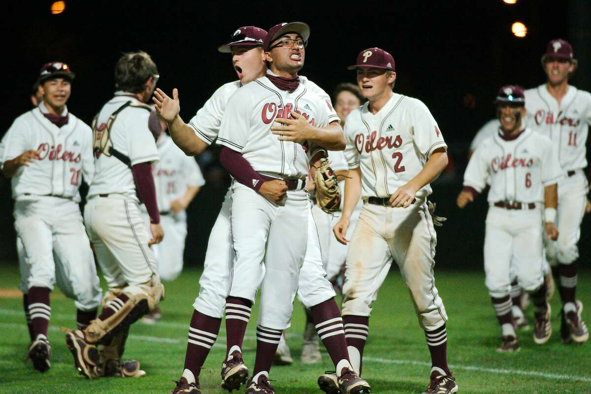 Pearland?•s Isaac Garcia (4) and the Oilers celebrate after defeating Kingwood Thursday, May 13 at Pearland High School.
