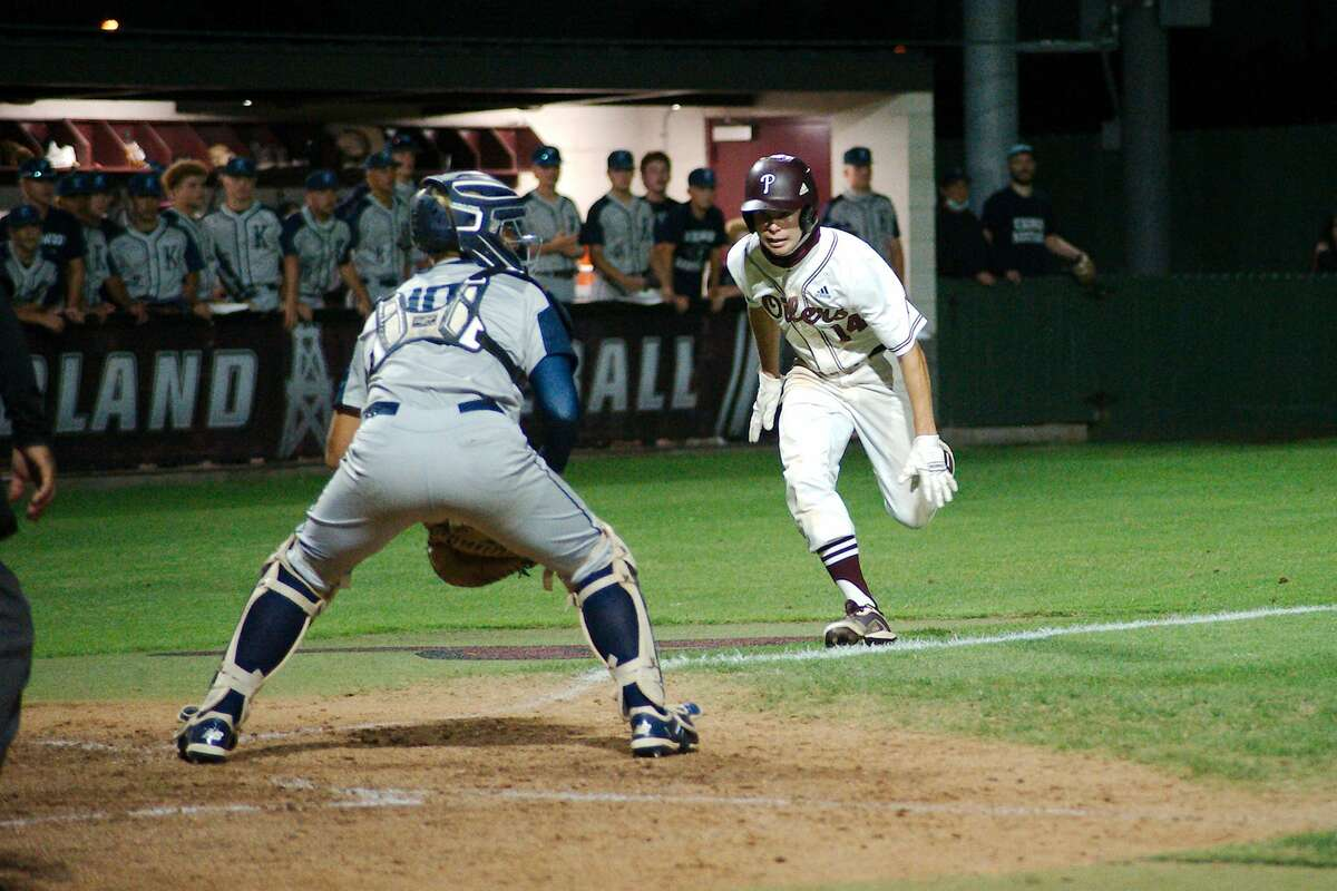 Kingwood'sJonathan Mendoza (10) looks for the throw as Pearland'sBrett Smajstrla prepares to slide into home plate Thursday, May 13 at Pearland High School.
