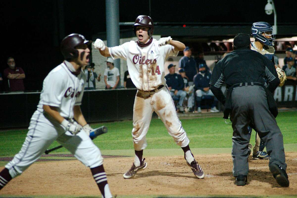 Pearland's Brett Smajstrla and Pearland's Carter Allen (3) celebrate after Smajstrla is ruled safe at home plate to tie the score at 4.