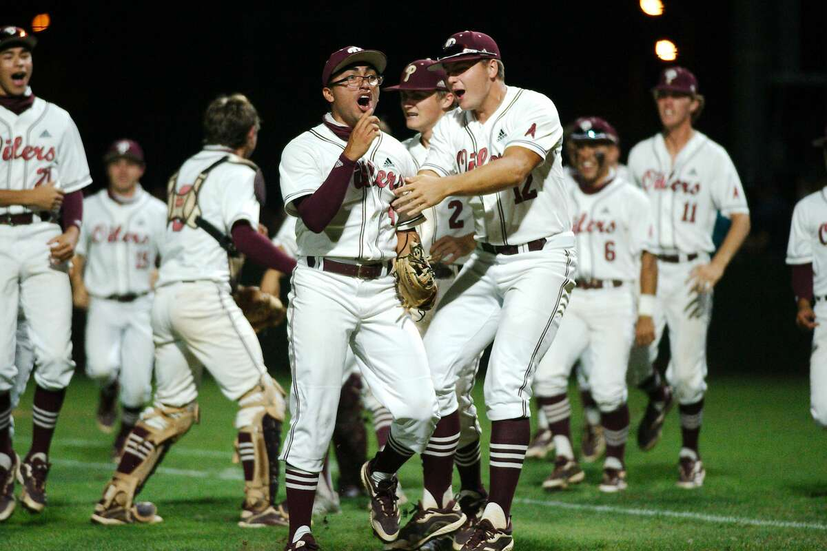 Pearland'sIsaac Garcia (4) and the Oilers celebrate after defeating Kingwood Thursday, at Pearland High School.