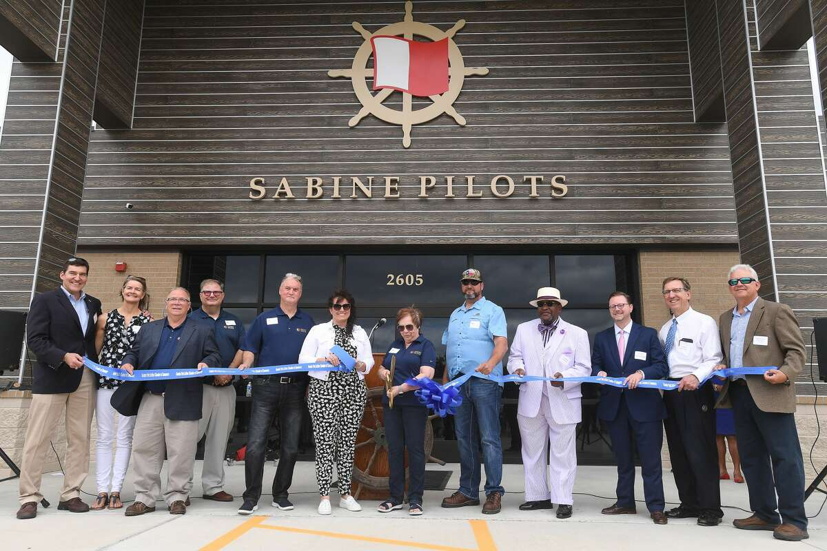A crowd gathers for a ribbon cutting and opening reception of the new Sabine Pilots headquarters on Jimmy Johnson Boulevard in. Port Arthur Thursday. Photo made Thursday, May 13, 2021 Kim Brent/The Enterprise