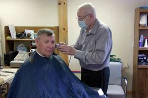 Fred Mazure has been cutting hair since 1963. (Rich Harp/For the Tribune)