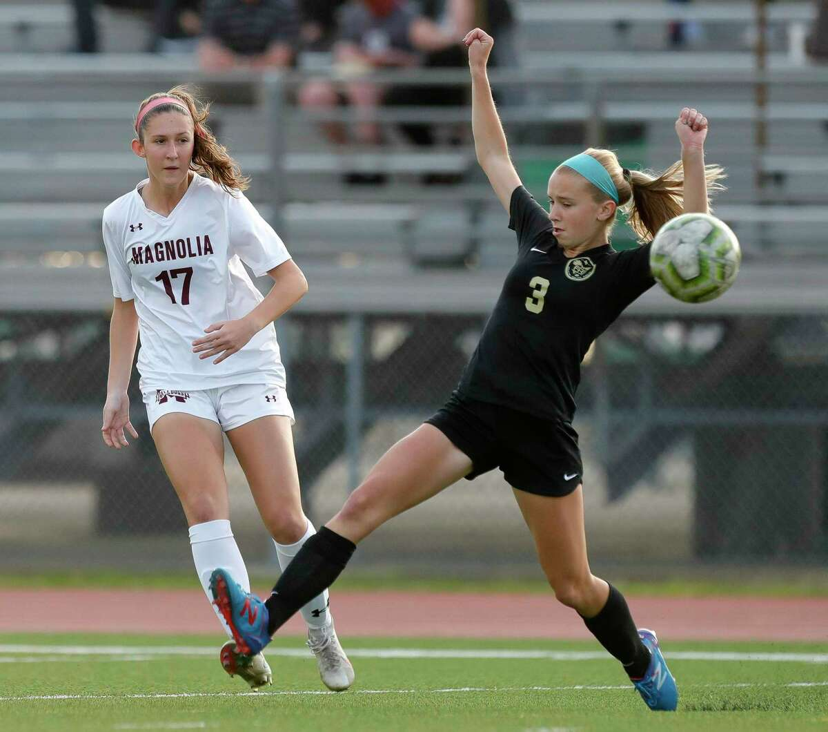 Magnolia's Sara Gianotti (17) makes a pass as Foster's Chloe Mills (3) gives pressure in the first period of a Region III-5A semifinal match at Cypress Falls High School, Tuesday, April 6, 2021, in Cypress.