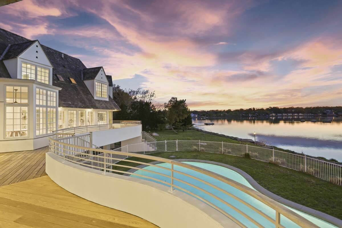 The home at 29 Brush Island Road in Darien, Conn. has 285 feet of private beachfront, the listing notes, along with its pool and floating dock that sits along the home's beachfront.