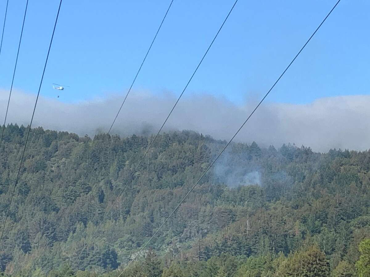 A Cal Fire helicopter is making water drops in the area.
