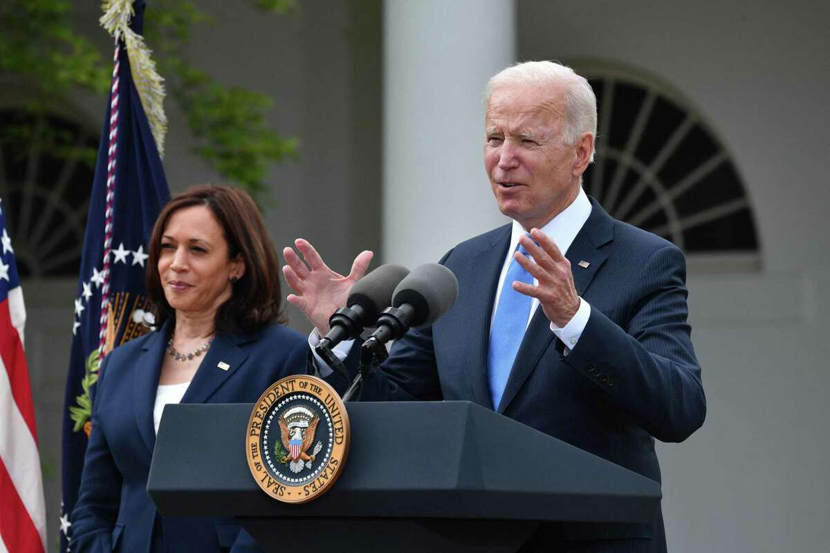 Vice President Kamala Harris looks on as President Joe Biden delivers remarks on COVID-19 response and the vaccination program, from the Rose Garden of the White House, Washington, D.C., on Thursday, May 13, 2021. (Nicholas Kamm/AFP/Getty Images/TNS)