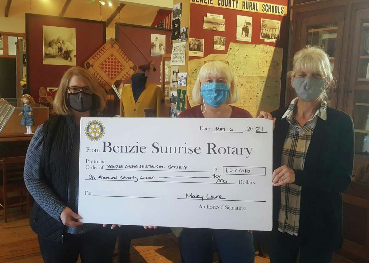 Benzie Sunrise Rotary Foundation President Mary Lane presents a symbolic big check to Pat Campbell and Barbara Mort of the Benzie Area Historical Society. (Courtesy Photo)