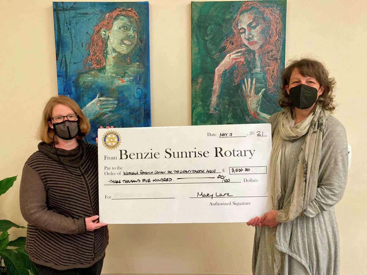 Benzie Sunrise Rotary Foundation President Mary Lane presenting a symbolic big check toJuliette Schultz of the Women's Resource Center (Courtesy Photo)