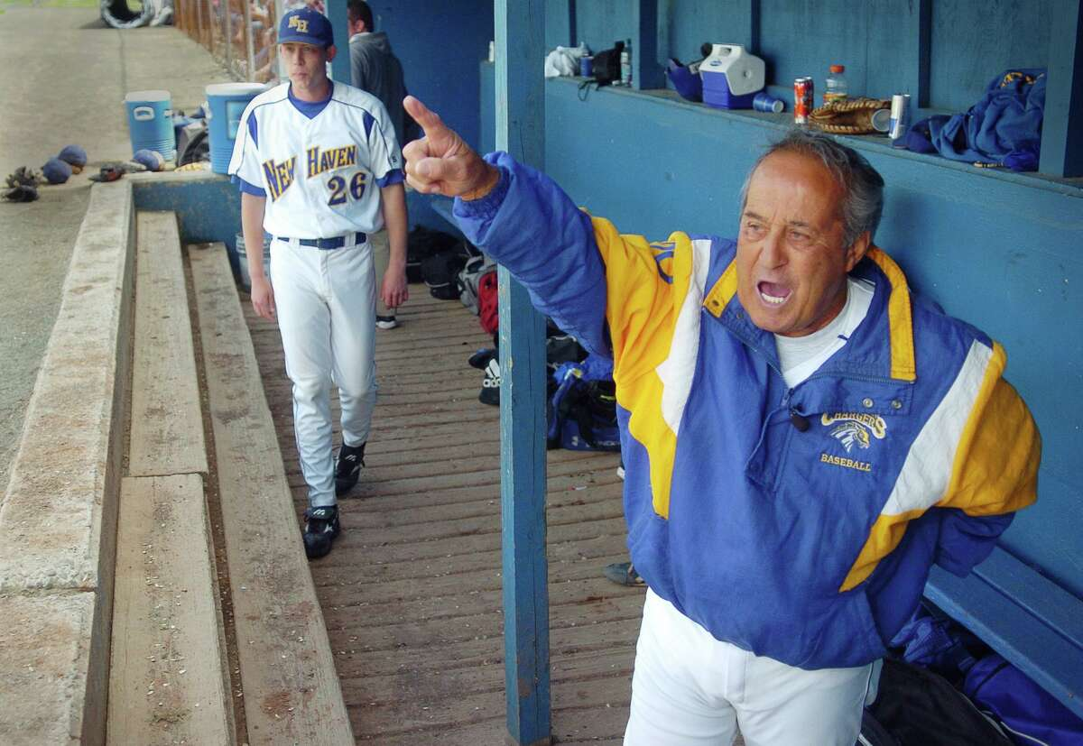 """05/07/06 - Frank """"Porky"""" Vieira yells in victory after the Chargers' Ken Appel steals second in the bottom of the eighth inning in the University of New Haven's game against Molloy. Vieria, a native of Bridgeport, is retiring at the end of the season."""