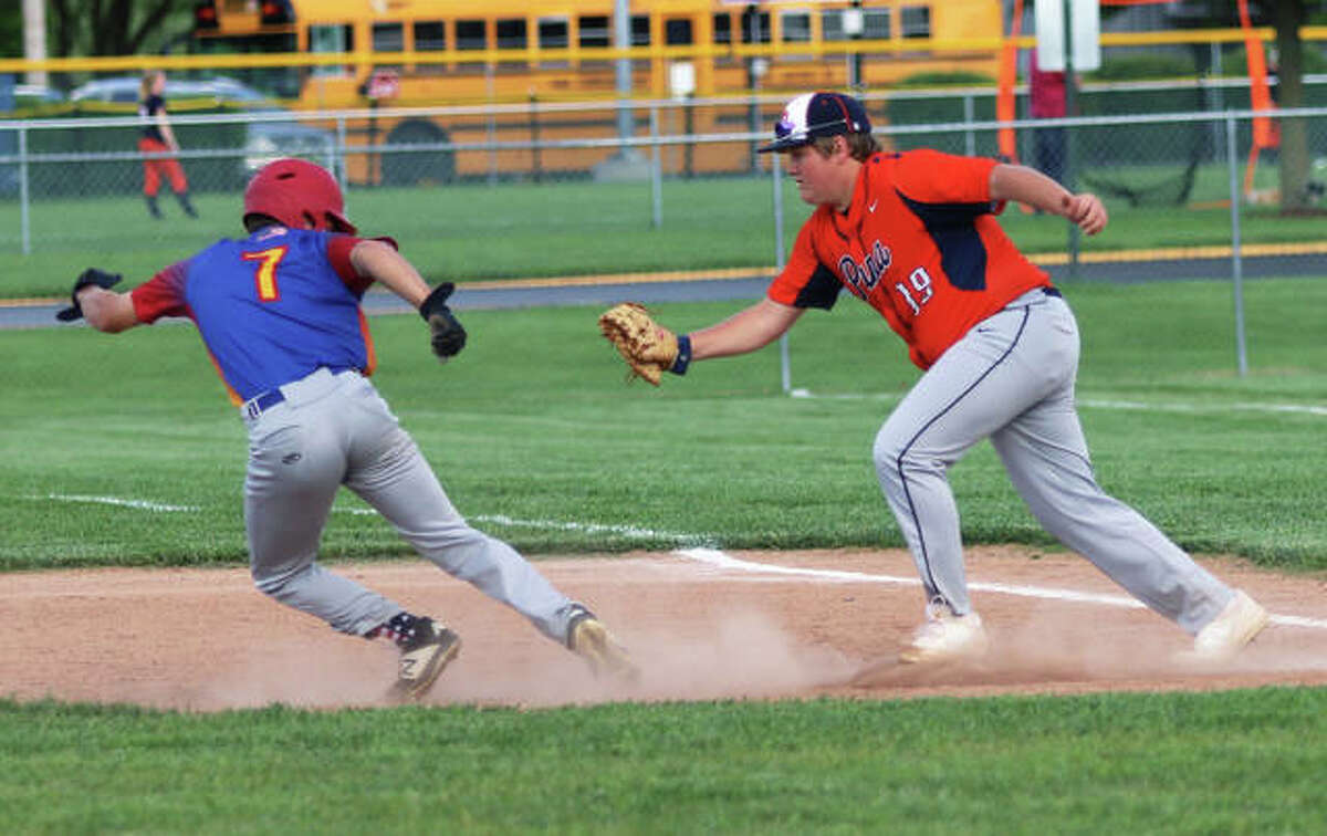 Roxana's Ted Webb (left) tries to avoid the tag from Pana's first baseman after getting picked off in the second inning Thursday at Roxana Park.