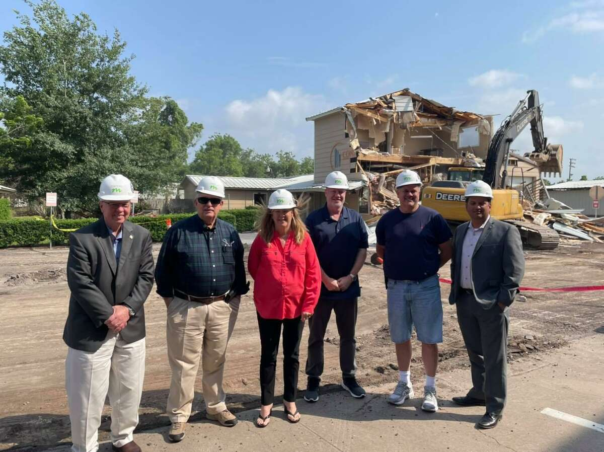 Doug Hooten, CEO, Commissioner Steve Williams, Commissioner Karen Plummer, Commissioner Robert Pinard, Commissioner Kevin Brost, and Project Architect Ricardo Martinez stand in the construction site for the ESD 11 MHS building