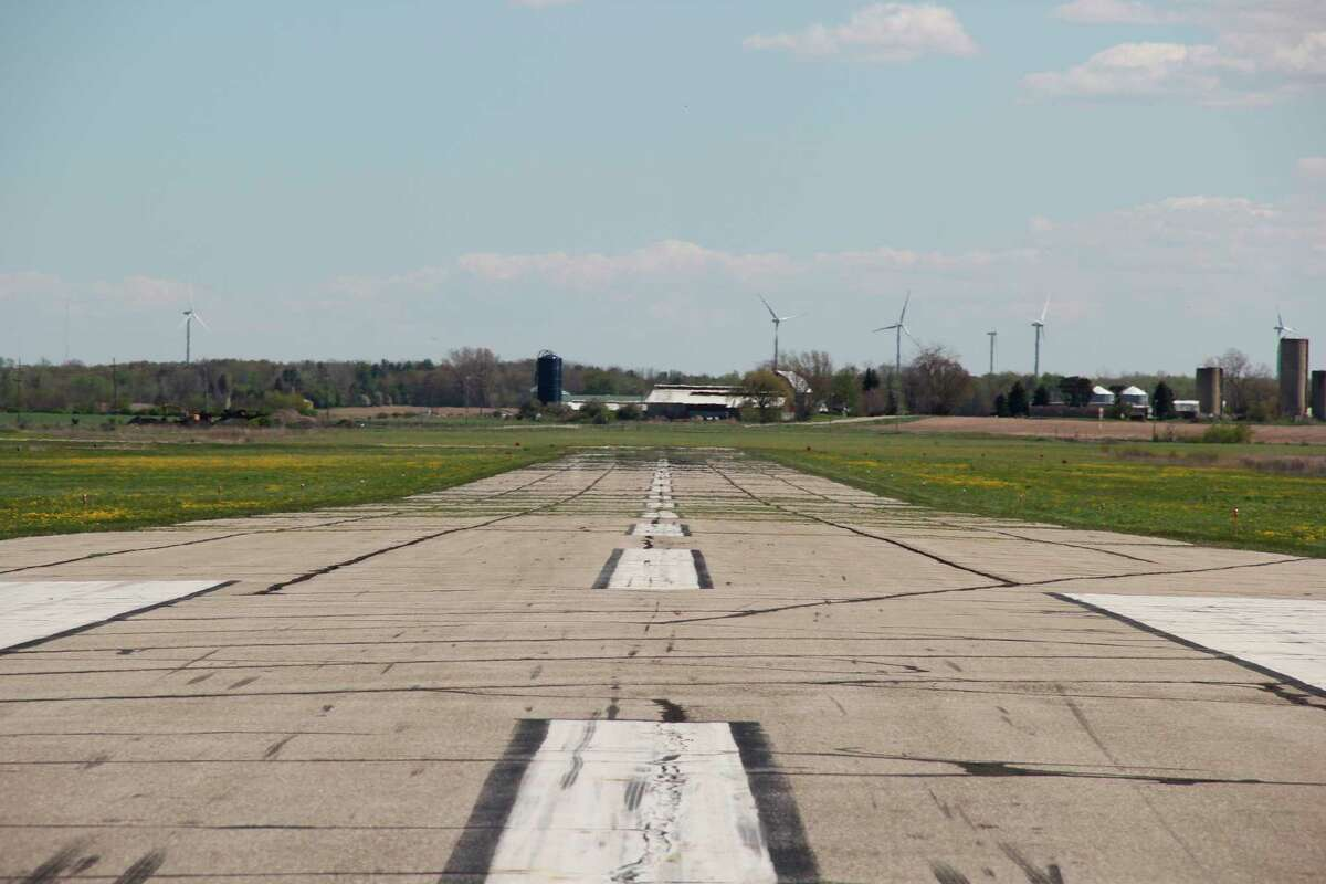 The long runway at Huron County Memorial Airport, which is scheduled to have a new layer of asphalt put on over the summer. The runway will be closed for two months while the shorter runway will be closed for two week. (Robert Creenan/Huron Daily Tribune)