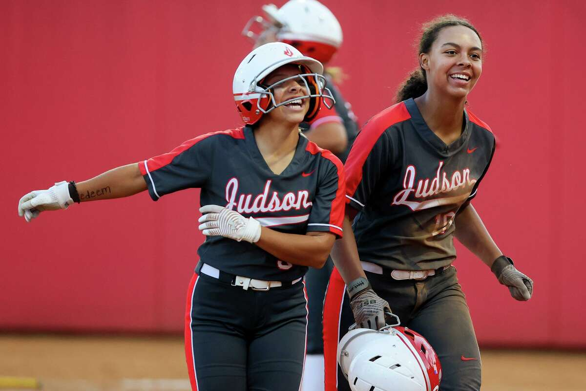 Judson's Ari Alejandro, left, and Keely Williams return to the dug out after scoring runs in the seventh inning of their one-game Class 6A softball playoff game with Round Rock at Buda Hays High School in Buda on Thursday, May 12, 2021. Judson scored five runs in the top of the seventh inning to beat Round Rock 7-4.