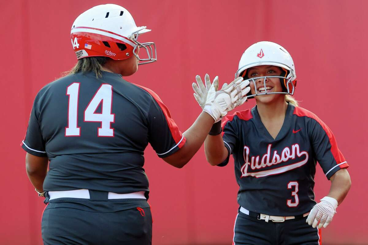 Judson's Ari Alejandro, right, is congratulated by Lauryn Ramos after scoring a run in the third inning of their one-game Class 6A softball playoff game with Round Rock at Buda Hays High School in Buda on Thursday, May 12, 2021. Judson scored five runs in the top of the seventh inning to beat Round Rock 7-4.