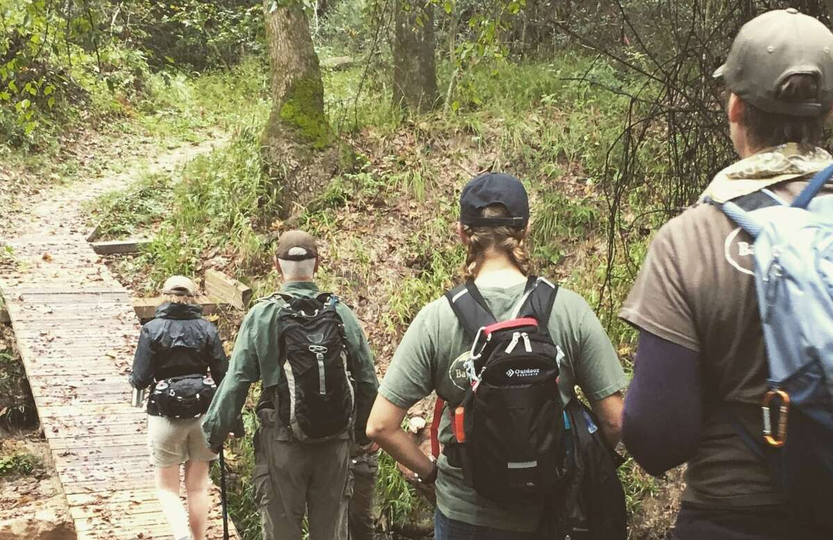 A trail walk at the Bayou Land Conservancy.