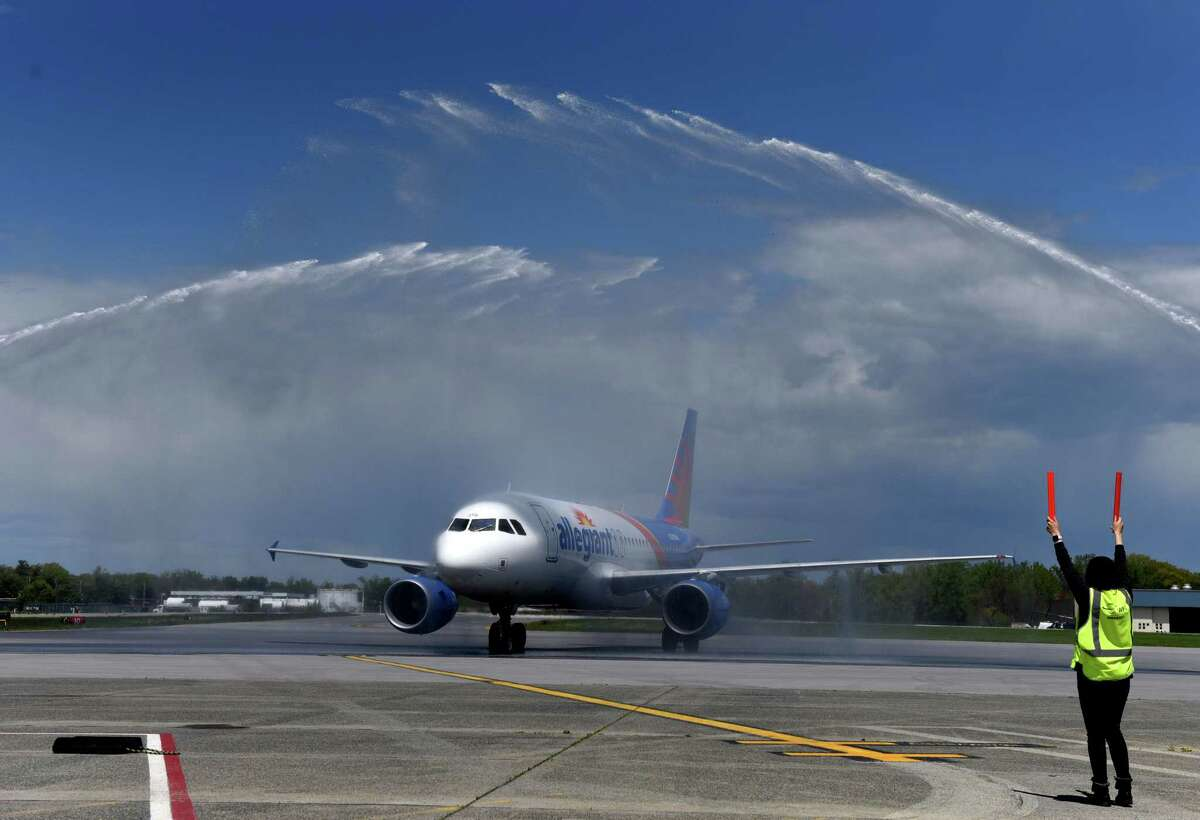 Allegiant Air's first nonstop flight to Nashville arrives at Albany International Airport under a celebratory salute from airport firetrucks on Friday, May 14, 2021, in Colonie, N.Y. (Will Waldron/Times Union)