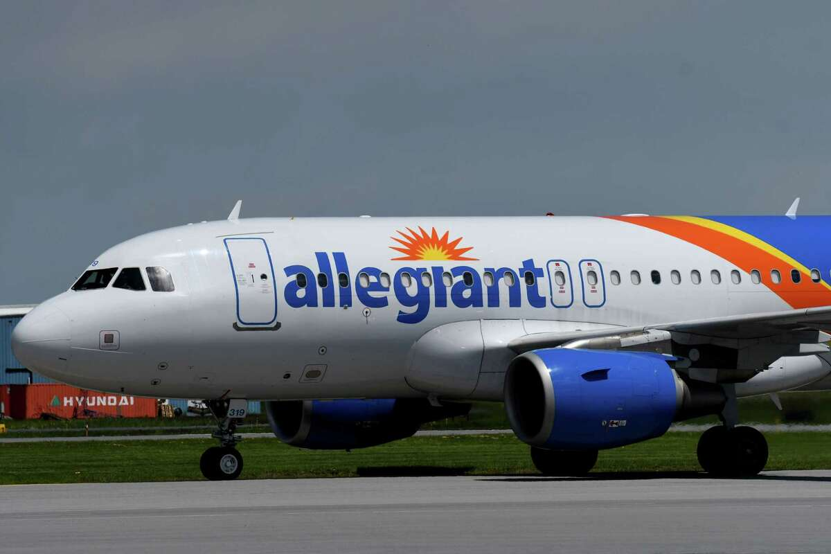 A 32-year-old woman from the Adirondacks was arrested at Albany International Airport after she slipped through a security door to try to get herluggage from an Allegiant flight, the Albany County sheriff's office said. (Will Waldron/Times Union)