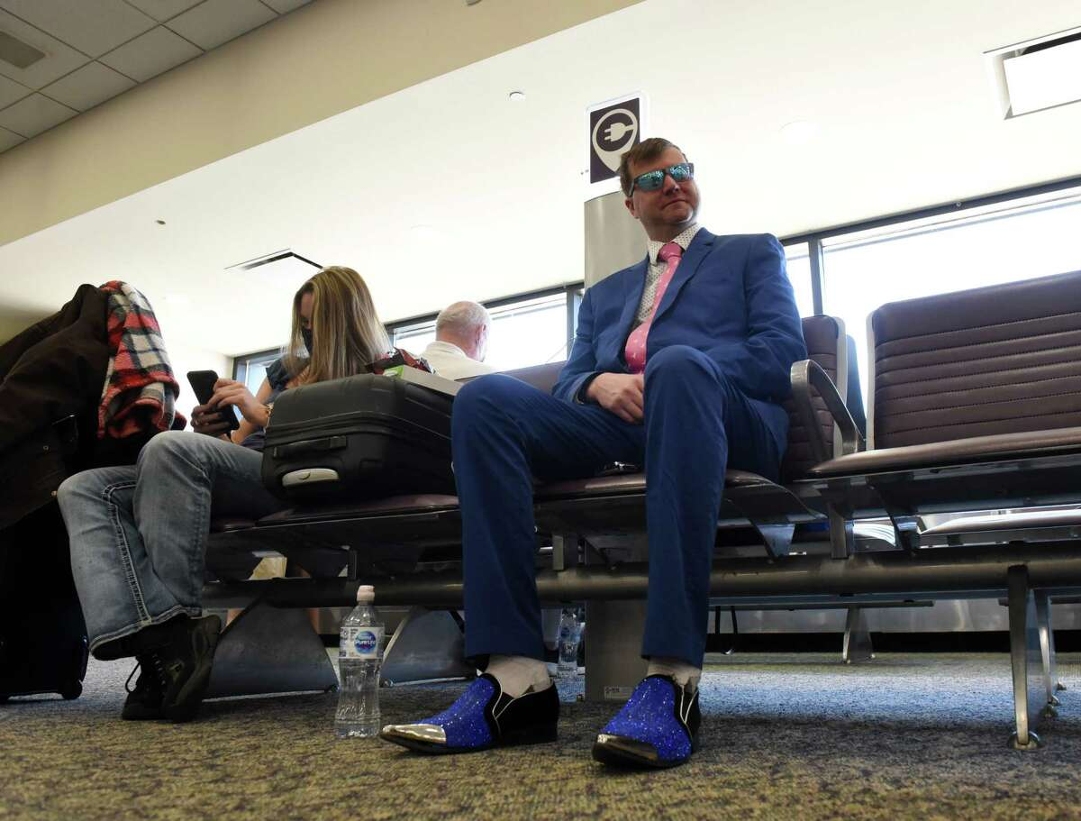 Travis Winter of Albany dresses the part for a trip to Nashville as he waits to board Allegiant Air's first nonstop flight to the Music City from Albany International Airport on Friday, May 14, 2021, in Colonie, N.Y. (Will Waldron/Times Union)