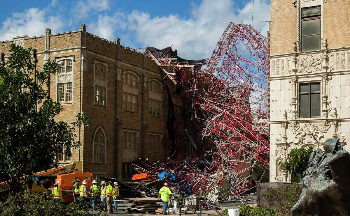 A construction crew worked to clean up collapsed scaffolding on Sept. 20, 2019, in the 300 block of East Martin Street in San Antonio. High winds from a storm caused the scaffolding to fall from the side of the AT&T building and land on St. Mark's Episcopal Church property.
