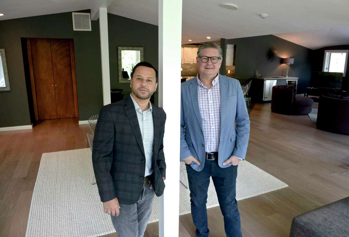 Mark Madonna, left, and Jeff Phillips from Madonna & Phillips Real Estate Group at William Pitt Sotheby's International Realty, stand in a new listing from Roxbury, Conn, on Thursday morning, May 13, 2021.