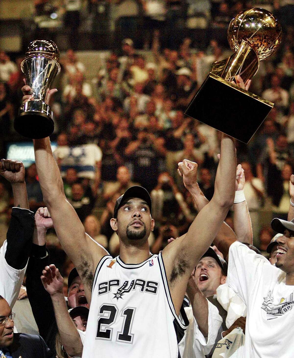 Spurs great Tim Duncan celebrates the 2005 championship and MVP. Duncan filled up the stat sheet, but he led with the heart of a champion.