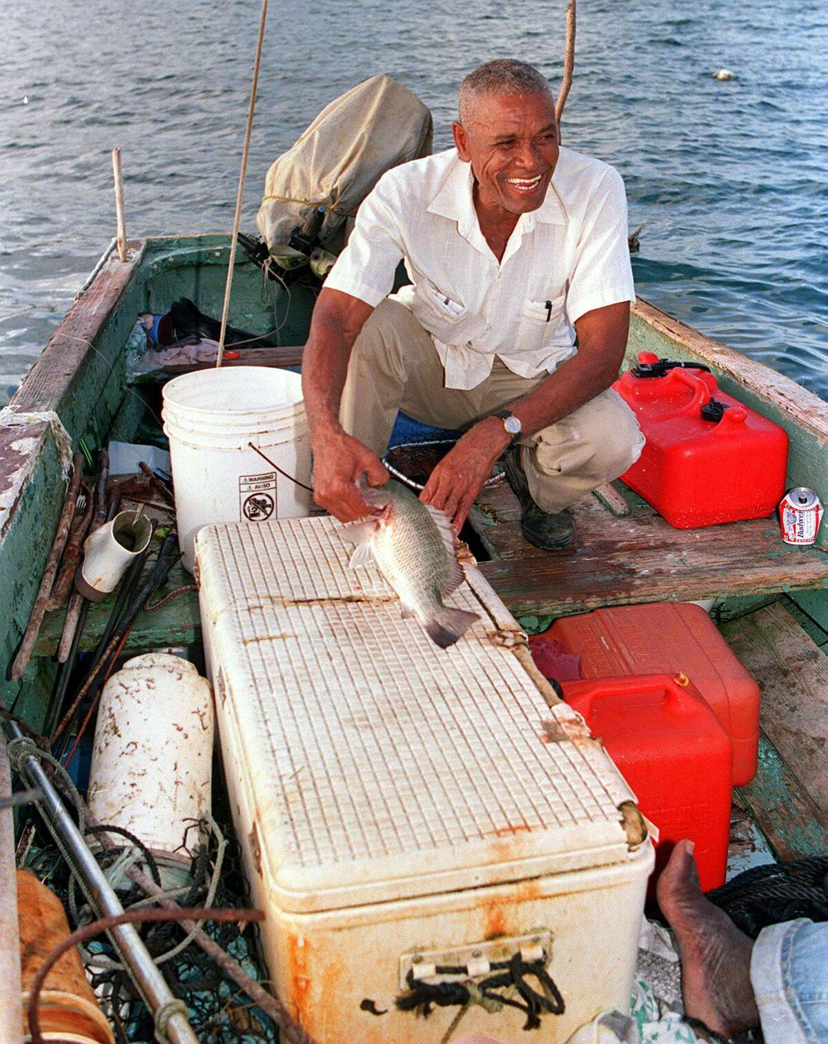 """Tim Duncan's father, William, fishes at the Christiansted Wharf in St. Croix. """"I'm the product of so many,"""" Duncan said Friday. """"My islands, my mother and my father, my sisters and friends. Everyone has had a hand along the way in getting me here."""""""