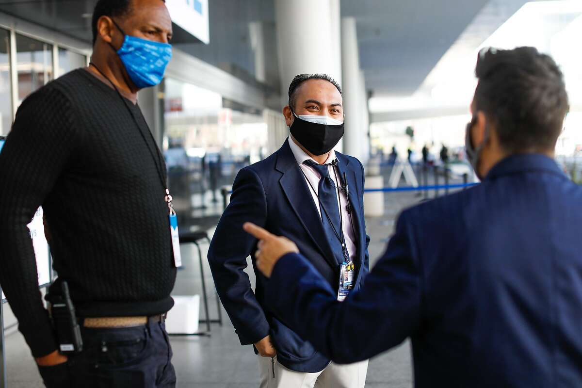 Security personnel at Moscone Center in San Francisco wear double masks on Feb. 12, 2021.