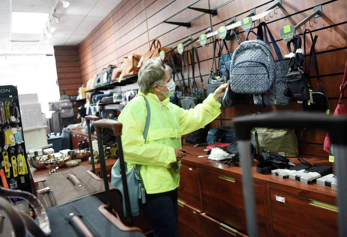 Stamford resident Pat Geils shops at Wagner's Fine Luggage and Gifts at the High Ridge Shopping Center in Stamford, Conn. Tuesday, May 11, 2021. The longtime mom-and-pop luggage shop will be closing down after more than 150 years in business. The store first opened in Rye, N.Y. in 1853 as a buggy whip and ox collar shop, changing locations and products through the years until it moved to its final location in the High Ridge Shopping Center in 1995.