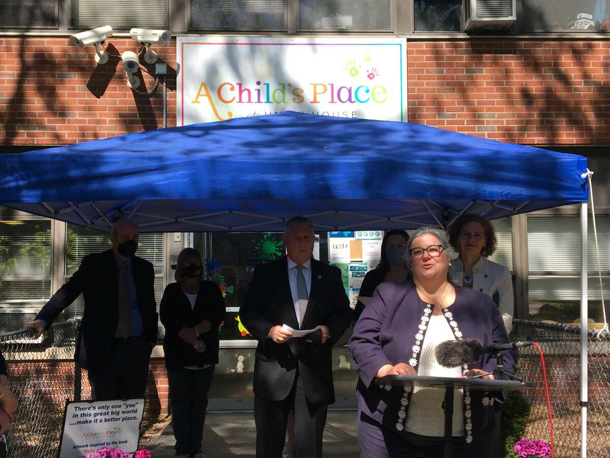 Assemblywoman Carrie Woerner stands outside A Child's Place at Unity House in Troy to discuss recent investment in the childcare industry.