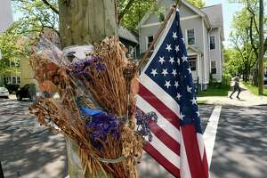 Flowers turned to dried flowers remain on the memorial for Kevin Jiang at the corner of Lawrence and Nicoll Street in New Haven on May 14, 2021 near where Jiang was shot and killed on February 6, 2021.