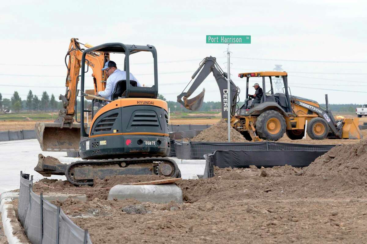 Small and large backhoes move dirt near new streets as construction continues in a new subdivision northwest of the the Grand Parkway and Bridgeland Creek Parkway, part of the Prairieland Village development Thursday, May. 13, 2021 in Cypress, TX.