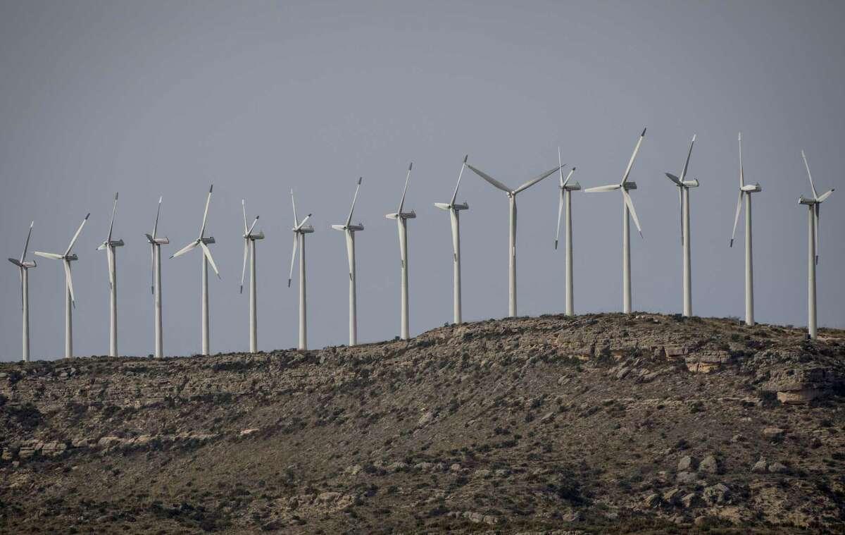 Wind Turbines operate in West Texas on Thursday, Dec. 19, 2019 near Rankin.