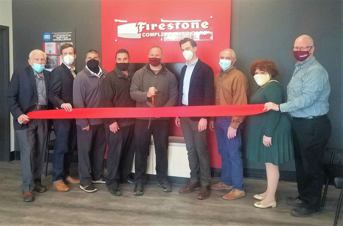 Firestone Complete Auto Care in Middletown celebrated a grand opening April 30. From left are Middlesex County Chamber of Commerce President Larry McHugh, state Sen. Matthew Lesser, Firestone New England Region Manger Eugene Bressette, Firestone Waterbury Manager Gary Carella, Middletown Manager Christopher Bernier, Mayor Ben Florsheim, property owner Charlie Kaoud, Central Business Bureau Chairwoman Pamela Steele, and Chamber Chairman Tom Byrne.