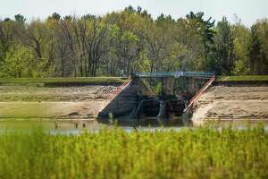 Part of Edenville Dam remains as the water level of Wixom Lake is still extremely low Friday in Edenville. (Katy Kildee/kkildee@mdn.net)
