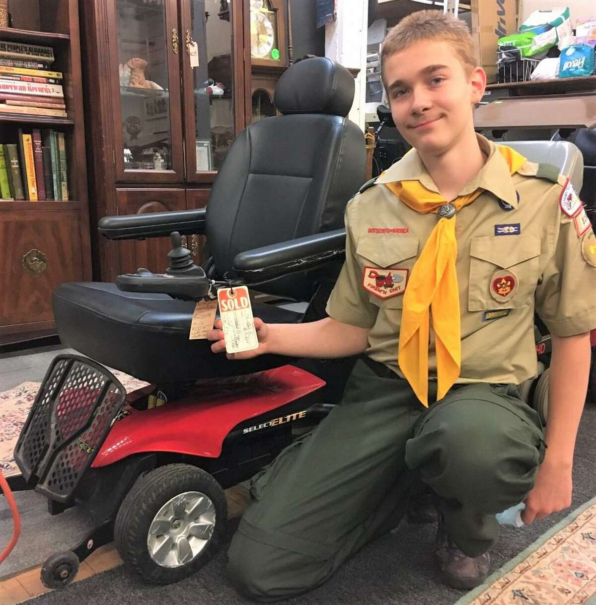 Middletown Eagle Scout candidate Michael Kline, 15, recently learned about a local woman, Adela Santiago, who needed a special wheelchair to get around, but couldn't afford one. He returned enough bottles and cans during a drive to purchase the $500 scooter for her - as a surprise.
