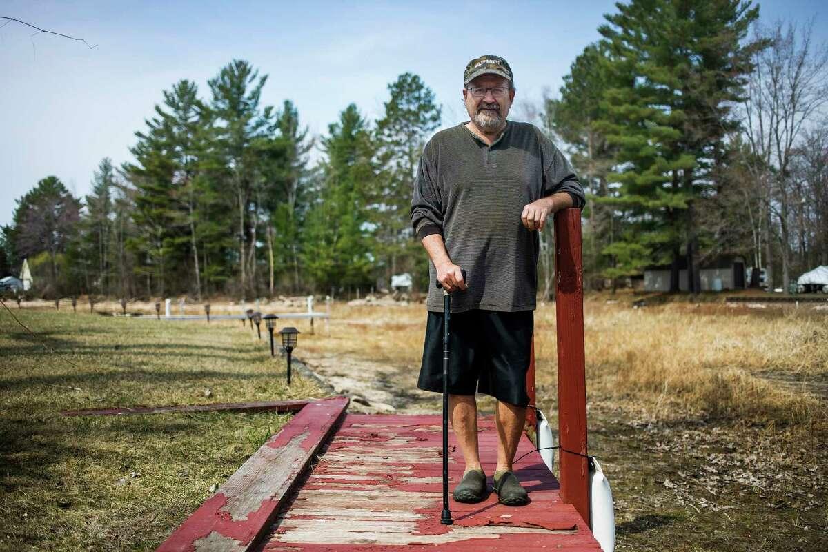 Bill Vasicek poses for a portrait on the dock in the backyard of his home Wednesday, April 7 in Hope. (Katy Kildee/kkildee@mdn.net)