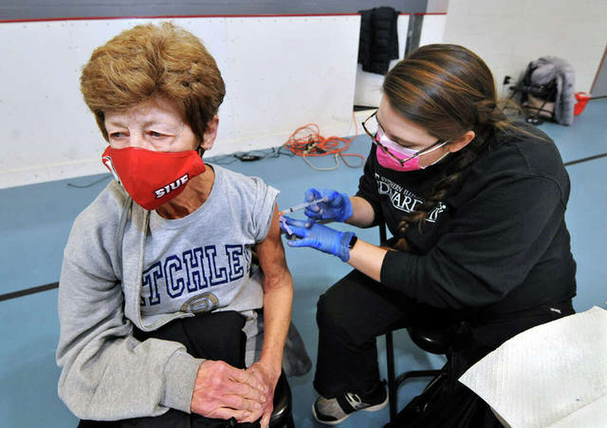 Building service worker at Southern Illinois University Edwardsville Donna Atchley, left, receives a vaccine for COVID-19 from SIUE Health Service RN Makala Boyles at the SIUE Fitness Center on Feb. 17.