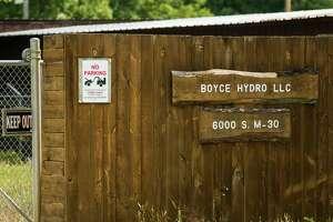 Boyce Hydro signs are seen near the Edenville Dam September 22, 2020. (Katy Kildee/kkildee@mdn.net)