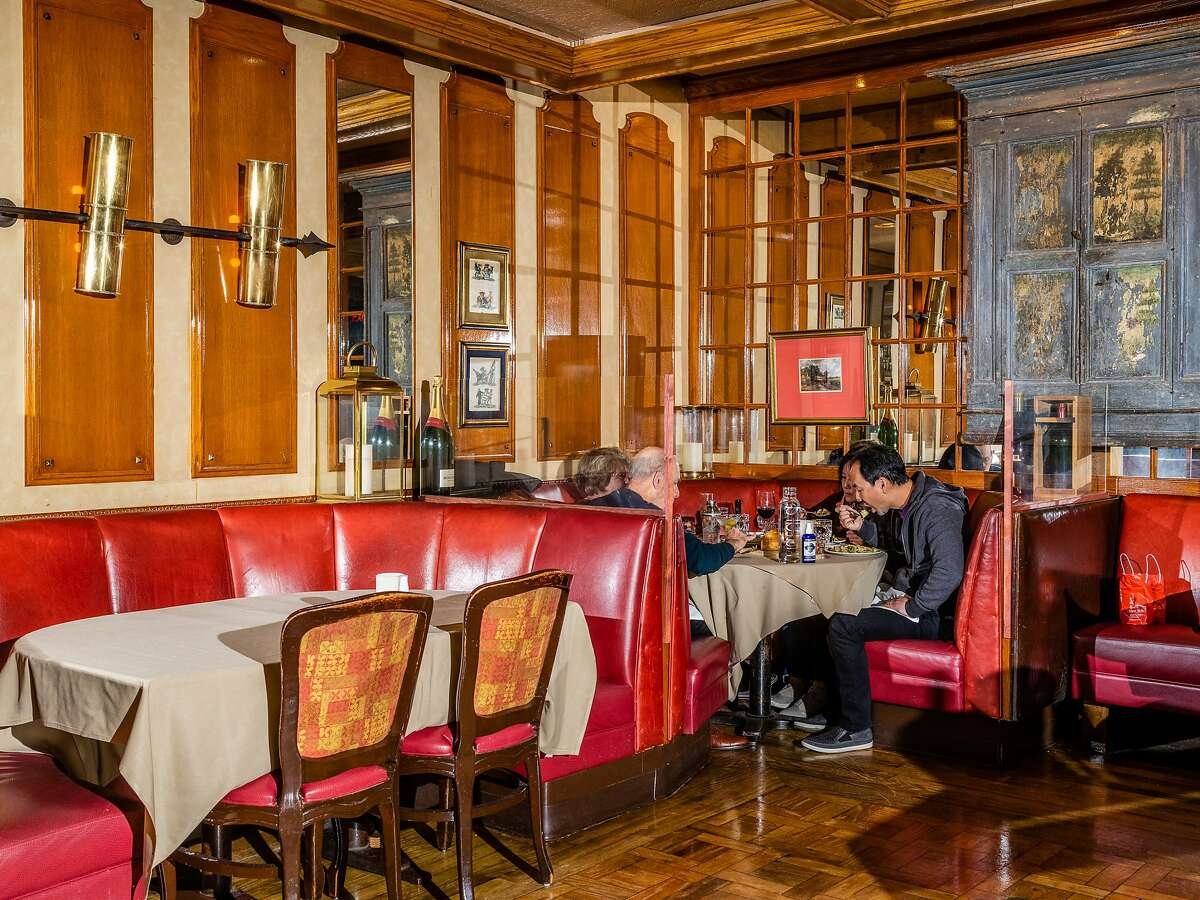 Diners spaced out in the dining room after indoor dining restrictions allow for up to 25% capacity at House of Prime Rib in San Francisco, Calif. on Friday, October 30, 2020.