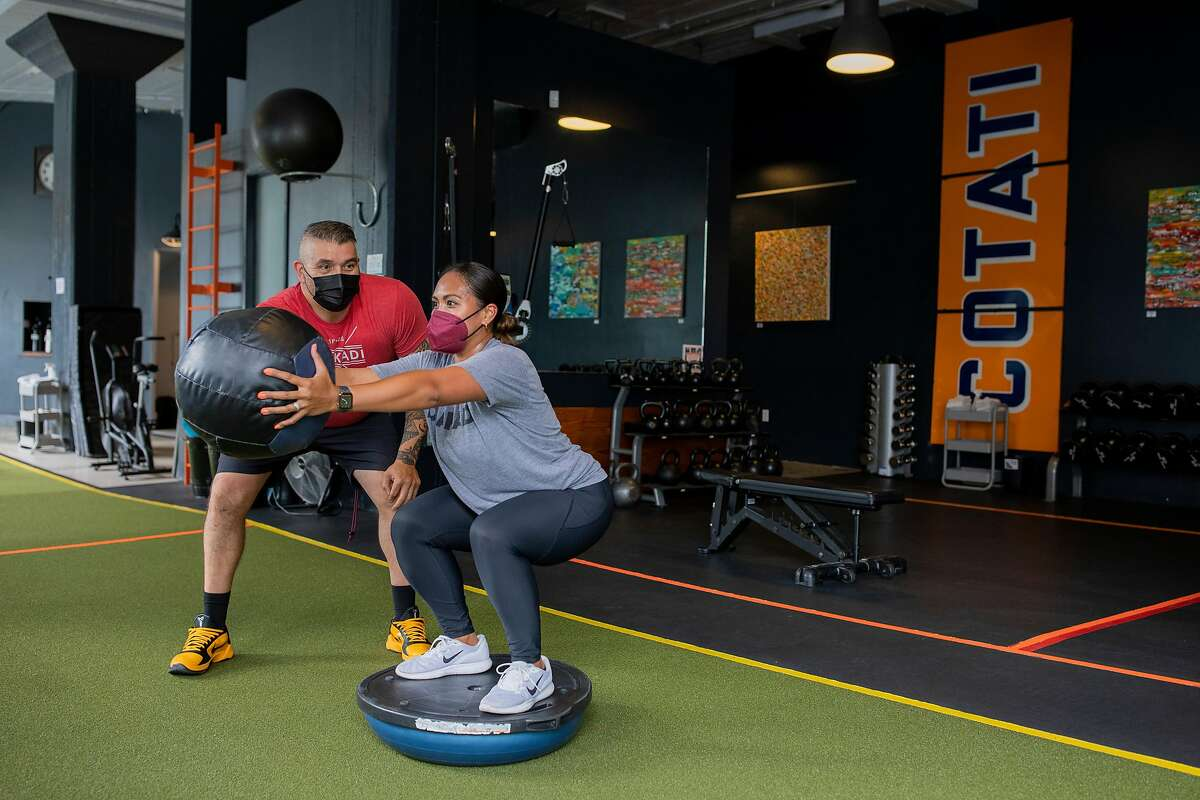 Tommy Armenta trains Tiana Dolorfino at Diakadi Fitness in San Francisco. The gym's co-owner, Bill Polson, says he thinks more people will come to fitness centers after consumer confidence increases.