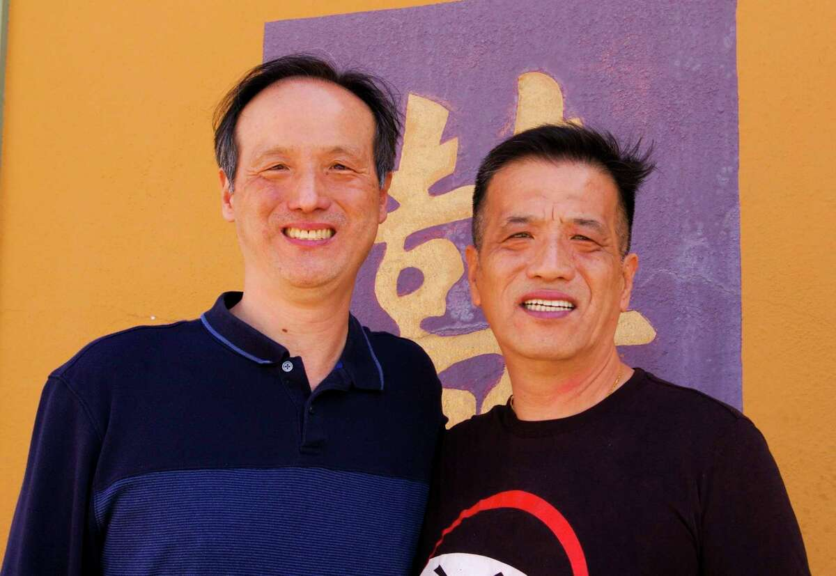 David Che, left, and his brother, Brian Che, both originally from South Korea, moved to Flint with their parents and their sister in 1978. In 1985, their parents opened China Palace in Midland. The brothers also opened Ghengis Khan Mongolian BBQ in 2005. (Photo by Niky House)